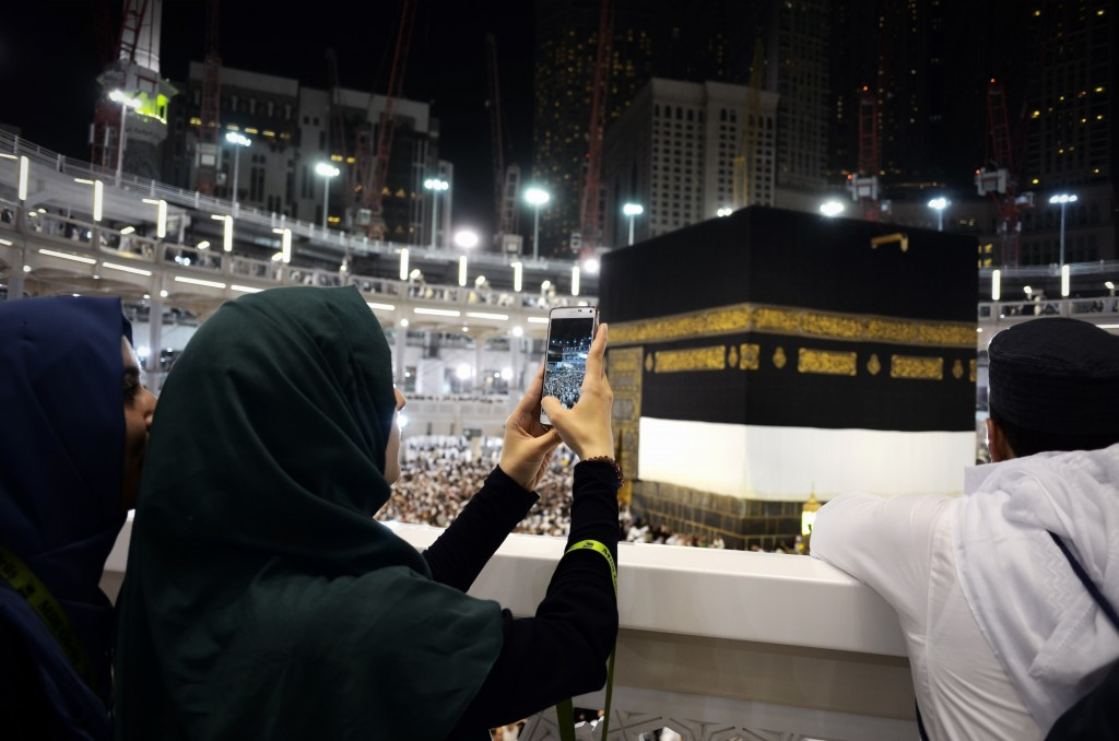 Muslim pilgrims take picture near the Islam's holiest shrine, the Kaaba, at the Grand Mosque in the Saudi holy city of Mecca, late on September 20, 2015. The annual hajj pilgrimage begins on September 22, and more than a million faithful have already flocked to Saudi Arabia in preparation for what will for many be the highlight of their spiritual lives. AFP PHOTO / MOHAMMED AL-SHAIKH        (Photo credit should read MOHAMMED AL-SHAIKH/AFP/Getty Images)