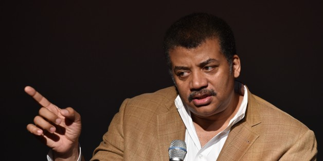 "Neil deGrasse Tyson, astrophysicist, ""Cosmos"" television show host and Frederick P. Rose Director of the Hayden Planetarium at the American Museum of Natural History speaks August 4, 2014 after a screening of James Cameron's ""Deepsea Challenge 3D"" film at the museum in New York.  AFP PHOTO/Stan HONDA        (Photo credit should read STAN HONDA/AFP/Getty Images)"